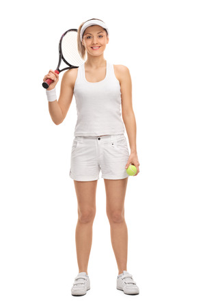 racquet: Female tennis player holding a racquet and a tennis ball isolated on white background Stock Photo