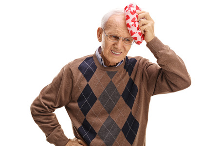 experiencing: Elderly man experiencing a headache isolated on white background Stock Photo