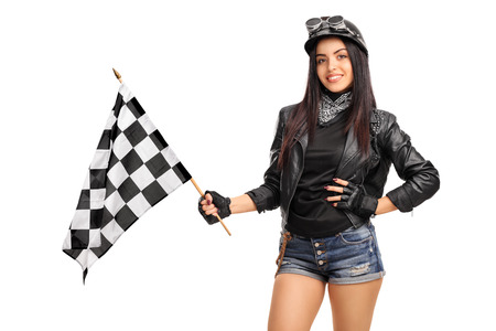 subculture: Female biker waving a checkered race flag isolated on white background Stock Photo