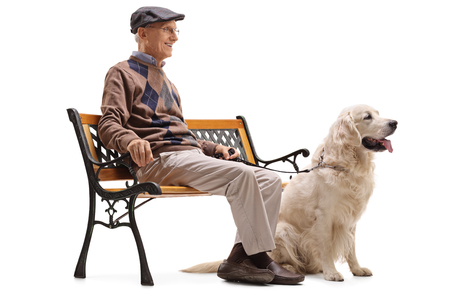 Senior man sitting on a bench with his dog isolated on white background