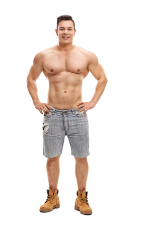 Shirtless muscular guy posing and looking at the camera isolated on white background Stock Photo