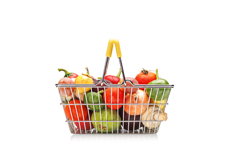 basket: Shopping basket full of fruit and vegetables isolated on white background