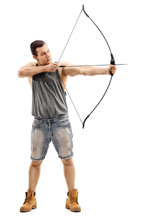 aiming: Full length portrait of a man aiming with a bow and arrow isolated on white background Stock Photo