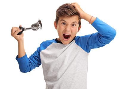 overjoyed: Overjoyed little boy honking a  horn isolated on white background Stock Photo