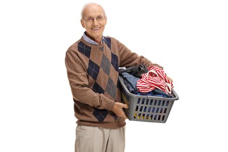 Elderly man holding a laundry basket full of clothes isolated on white background Stock Photo