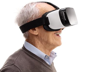 experiencing: Amazed senior using a VR headset and experiencing virtual reality isolated on white background Stock Photo