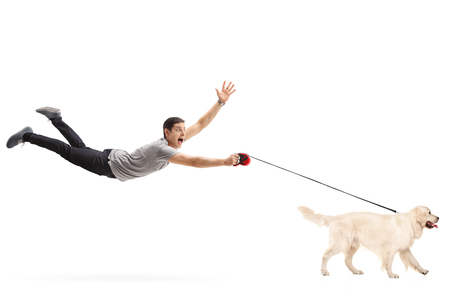 Guy being pulled by his dog isolated on white background
