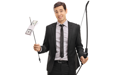 Happy businessman holding a bow and an arrow with a bundle of money isolated on white background