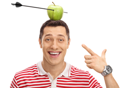 pierced: Delighted man pointing at an apple pierced by an arrow on his head isolated on white background