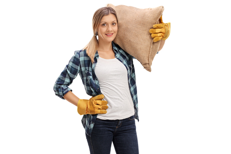 Female agricultural worker carrying a burlap sack isolated on white background