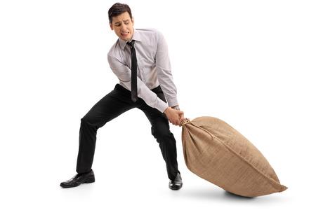 sackful: Young businessman pulling a burlap sack isolated on white background