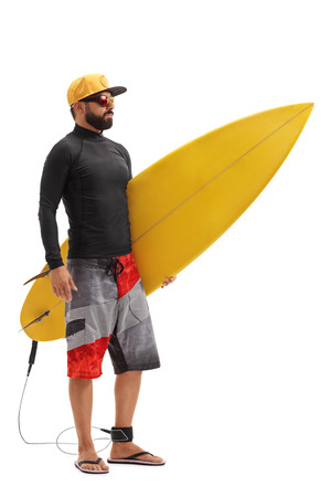 isolated man: Full length portrait of a male surfer holding a surfboard isolated on white background Stock Photo
