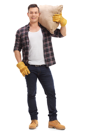 sackful: Full length portrait of a male agricultural worker posing with a burlap sack isolated on white background Stock Photo