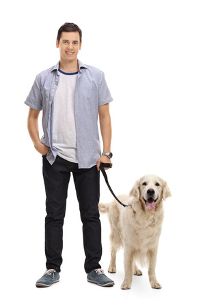 Full length portrait of a young man posing with his dog isolated on white background
