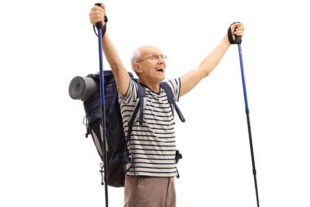 overjoyed: Overjoyed elderly hiker gesturing happiness isolated on white background