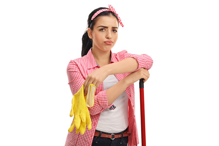 tired: Tired young woman with a pair of cleaning gloves and a mop isolated on white background Stock Photo