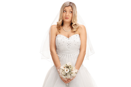 adultery: Embarrassed bride with a wedding flower isolated on white background Stock Photo