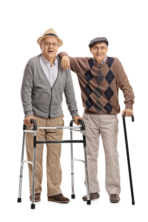 two men: Full length portrait of two elderly men with a walker and a cane isolated on white background