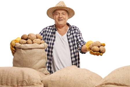 sackful: Mature farmer with a burlap sack and potatoes isolated on white background