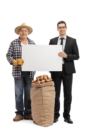 sackful: Full length portrait of a farmer and a businessman holding a blank cardboard sign isolated on white background