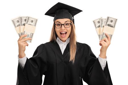 overjoyed: Overjoyed graduate student holding bundles of money isolated on white background