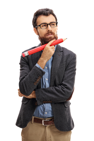 person writing: Pensive bearded guy holding a big pencil isolated on white background