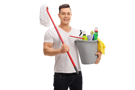 mops: Young man holding a bucket full of cleaning products and a mop isolated on white background