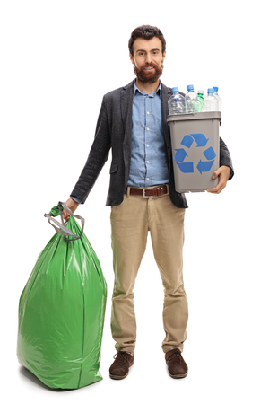 Full length portrait of a man with a recycling bin full of plastic bottles and a garbage bag isolated on white background Standard-Bild
