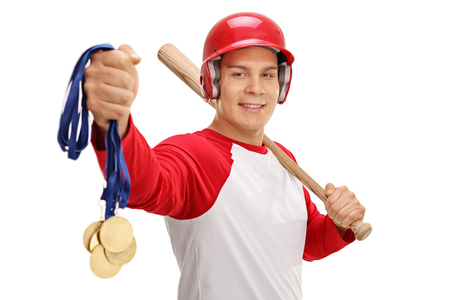 ganado: Baseball player holding gold medals and a bat isolated on white background