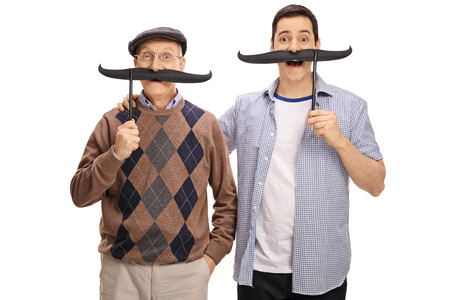 Senior and a young man posing with big fake moustaches isolated on white background Stock Photo