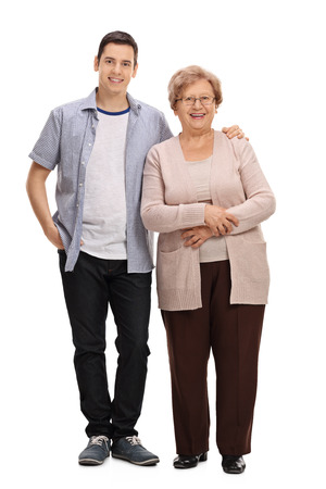 Full length portrait of a young man and a mature woman isolated on white background Stock Photo