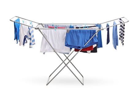 Rack dryer with clothes hanging isolated on white background