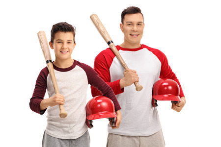 children sport: Little boy and a young man with baseball bats and helmets isolated on white background