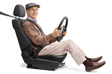 fastened: Joyful elderly man sitting on a car seat and looking at the camera isolated on white background Stock Photo