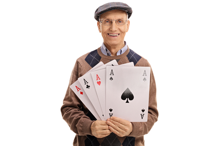 clubs diamonds: Cheerful mature man holding four aces isolated on white background