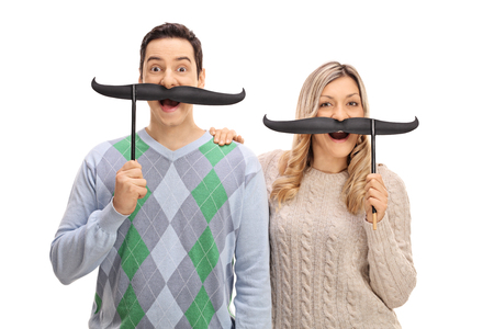 fake smile: Joyful young man and a woman posing with fake moustache isolated on white background Stock Photo