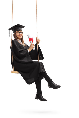Happy graduate student with a diploma sitting on a swing isolated on white background