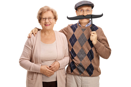 senior female: Mature woman and a mature man with big fake moustache isolated on white background