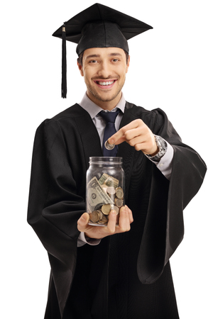 college fund savings: Graduate student putting a coin into a jar isolated on white background