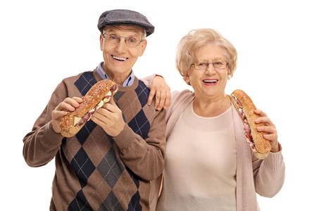 hombre comiendo: Seniors having sandwiches isolated on white background