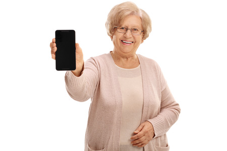 showing: Joyful mature lady showing a phone isolated on white background