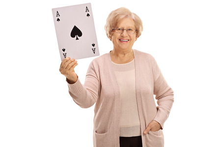 Happy mature woman showing an ace of spades card isolated on white background Stock Photo