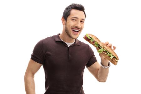 Joyful guy having a sandwich isolated on white background Stock Photo