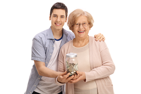 Young man and a mature woman holding a jar with money isolated on white background Stock Photo