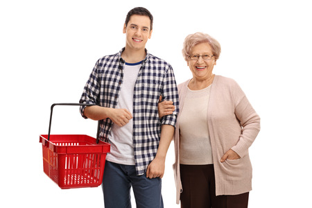 Young man with an empty shopping basket and an elderly woman isolated on white background