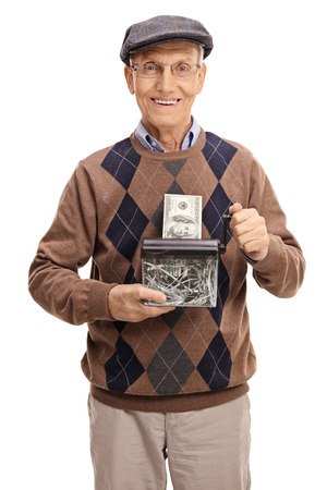 Happy senior destroying a dollar bill in a paper shredder isolated on white background