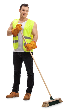 sweeper: Full length portrait of a waste collector with a broom isolated on white background