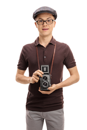 Teenage boy with a vintage outfit and an old camera isolated on white background Stock Photo