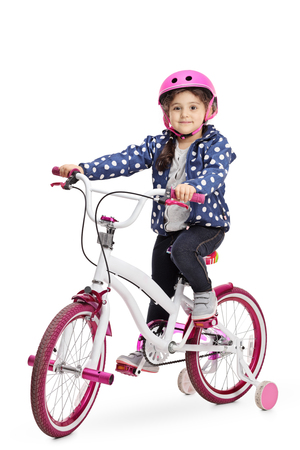 Cute little girl on a bike isolated on white background Stock Photo