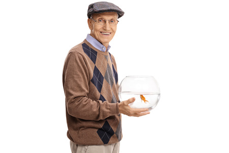 tank fish: Elderly man holding a bowl with a goldfish and looking at the camera isolated on white background Stock Photo
